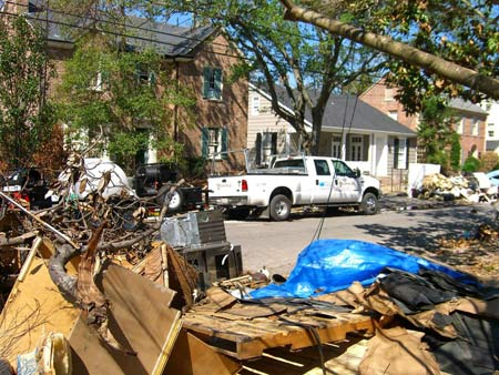 Streetside debris pile during Hurricane Katrina aftermath cleanup