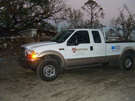White Ford BIOPRO truck near Hurricane Katrina damage