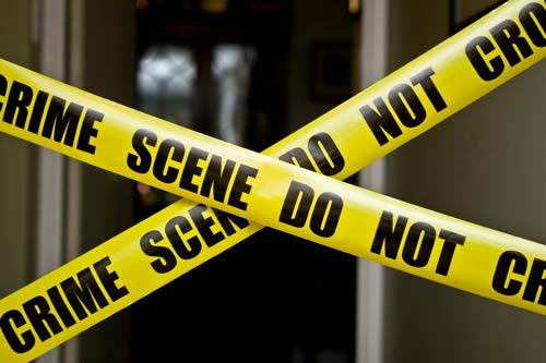Open door to Chandler home with crime scene tape up