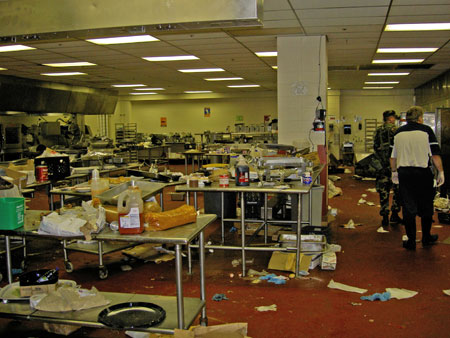 Interior of large kitchen damaged and debris left by Hurricane Katrina