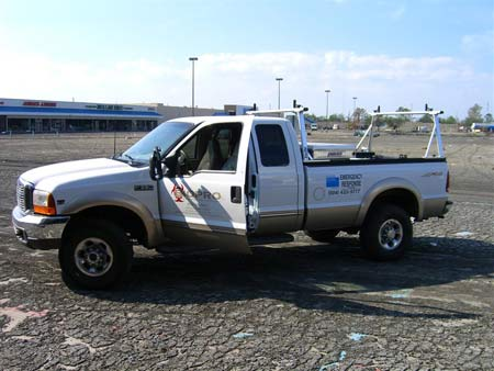 White Ford BIOPRO truck in empty New Orleans parking lot