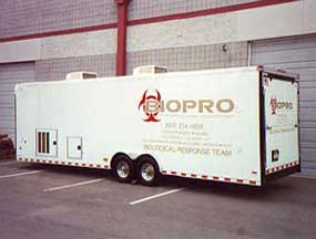 BIOPRO biohazard removal company trailer in front of Phoenix warehouse